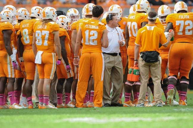 Oct 19, 2013; Knoxville, TN, USA; Tennessee Volunteers head coach Butch Jones speaks with his team during the second half against the South Carolina Gamecocks at Neyland Stadium. Tennessee won 23 to 21.  Mandatory Credit: Randy Sartin-USA TODAY Sports