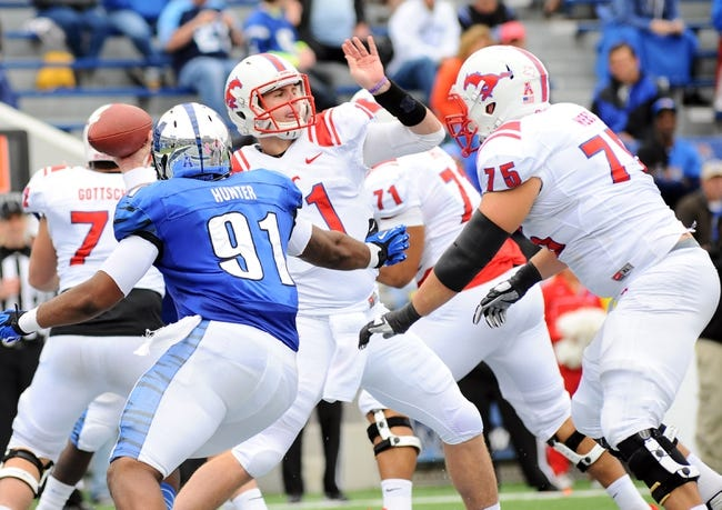 Oct 19, 2013; Memphis, TN, USA; Southern Methodist Mustangs quarterback Garrett Gilbert (11) throws the ball during the fourth quarter against the Memphis Tigers at Liberty Bowl Memorial. Southern Methodist Mustangs defeats Memphis Tigers 34 - 29. Mandatory Credit: Justin Ford-USA TODAY Sports