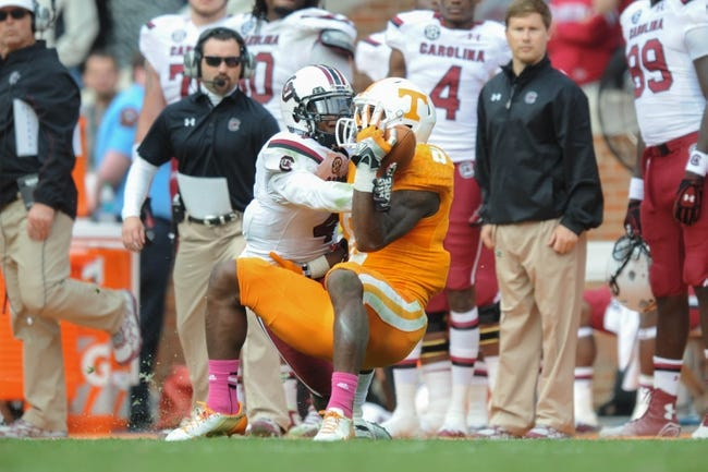 Oct 19, 2013; Knoxville, TN, USA; Tennessee Volunteers wide receiver Marquez North (8) catches a pass while being defended by South Carolina Gamecocks cornerback Ahmad Christian (4) during the second half at Neyland Stadium. Tennessee won 23 to 21.  Mandatory Credit: Randy Sartin-USA TODAY Sports