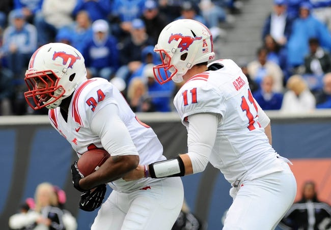 Oct 19, 2013; Memphis, TN, USA; Southern Methodist Mustangs quarterback Garrett Gilbert (11) hands the ball of to running back Traylon Shead (34) during the fourth quarter against Memphis Tigers at Liberty Bowl Memorial. Southern Methodist Mustangs defeats Memphis Tigers 34 - 29. Mandatory Credit: Justin Ford-USA TODAY Sports
