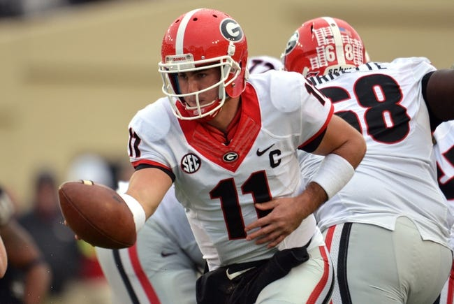 Oct 19, 2013; Nashville, TN, USA; Georgia Bulldogs quarterback Aaron Murray (11) drops back to hand off against the Vanderbilt Commodores during the first half at Vanderbilt Stadium. The Commodores beat the Bulldogs 31-27. Mandatory Credit: Don McPeak-USA TODAY Sports