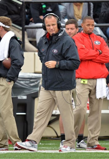 Oct 19, 2013; Nashville, TN, USA; Georgia Bulldogs head coach Mark Richt watches his team play against the Vanderbilt Commodores during the second half at Vanderbilt Stadium. The Commodores beat the Bulldogs 31-27. Mandatory Credit: Don McPeak-USA TODAY Sports