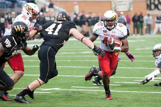 Oct 19, 2013; Winston-Salem, NC, USA; Maryland Terrapins running back Brandon Ross (45) runs the ball during the first quarter against the Wake Forest Demon Deacons at BB&T Field. Mandatory Credit: Jeremy Brevard-USA TODAY Sports