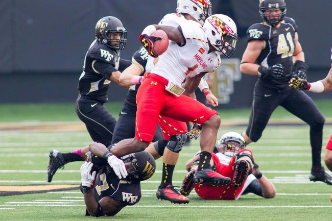 Oct 19, 2013; Winston-Salem, NC, USA; Maryland Terrapins wide receiver Stefon Diggs (1) runs out of the tackle of Wake Forest Demon Deacons cornerback Merrill Noel (7) during the first quarter at BB&T Field. Mandatory Credit: Jeremy Brevard-USA TODAY Sports