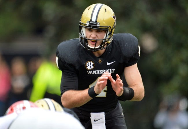 Oct 19, 2013; Nashville, TN, USA; Vanderbilt Commodores quarterback Patton Robinette (4) gives the snap count at the line against the Georgia Bulldogs during the second half at Vanderbilt Stadium. The Commodores beat the Bulldogs 31-27. Mandatory Credit: Don McPeak-USA TODAY Sports