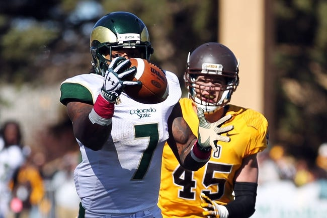 Oct 19, 2013; Laramie, WY, USA; Colorado State Rams running back Donnell Alexander (7) makes a catch for a touchdown in front of Wyoming Cowboys linebacker Lucas Wacha (45) during the third quarter at War Memorial Stadium.  The Rams defeated the Cowboys 52-22.   Mandatory Credit: Troy Babbitt-USA TODAY Sports