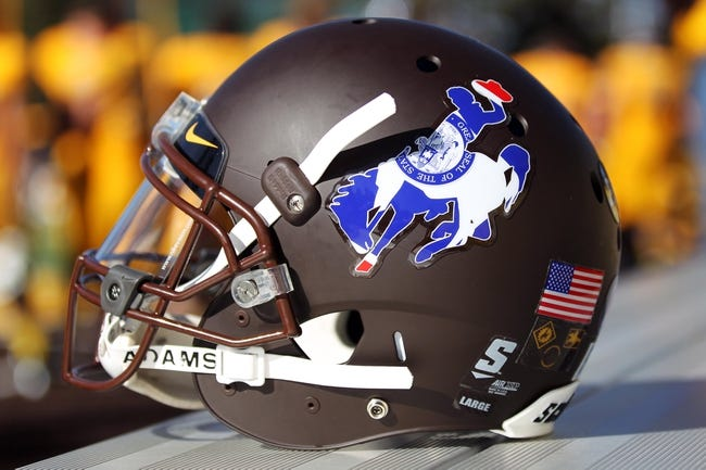 Oct 19, 2013; Laramie, WY, USA; A general view of the Wyoming Cowboys  helmet and the state flag within the steamboat logo during the game with the Colorado State Rams. The Rams defeated the Cowboys 52-22.   Mandatory Credit: Troy Babbitt-USA TODAY Sports