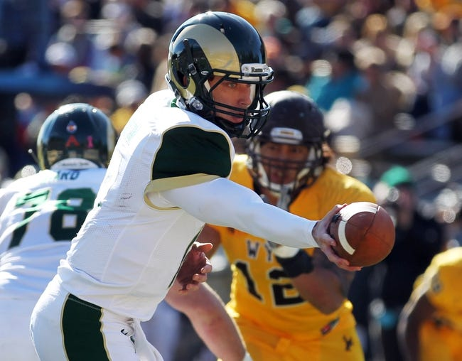 Oct 19, 2013; Laramie, WY, USA; Colorado State Rams quarterback Garrett Grayson (18) prepares to hand off against the Wyoming Cowboys during the third quarter at War Memorial Stadium.  The Rams defeated the Cowboys 52-22.   Mandatory Credit: Troy Babbitt-USA TODAY Sports