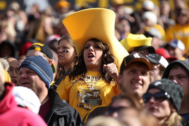 Oct 19, 2013; Laramie, WY, USA; A Wyoming Cowboys fan cheers against the Colorado State Rams during the second quarter at War Memorial Stadium. The Rams defeated the Cowboys 52-22.   Mandatory Credit: Troy Babbitt-USA TODAY Sports