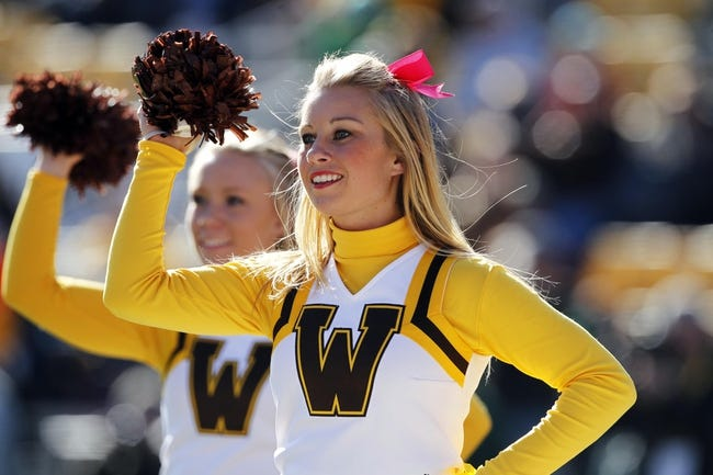 Oct 19, 2013; Laramie, WY, USA; A Wyoming Cowboys cheerleader during the game with the Colorado State Rams at War Memorial Stadium. The Rams defeated the Cowboys 52-22.   Mandatory Credit: Troy Babbitt-USA TODAY Sports