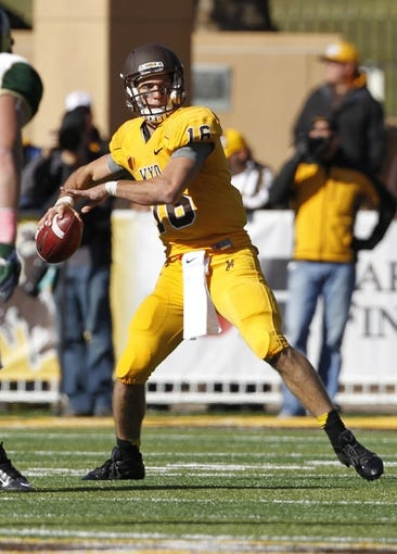 Oct 19, 2013; Laramie, WY, USA; Wyoming Cowboys quarterback Brett Smith (16) throws during the fourth quarter against the Colorado State Rams. The Rams defeated the Cowboys 52-22.   Mandatory Credit: Troy Babbitt-USA TODAY Sports