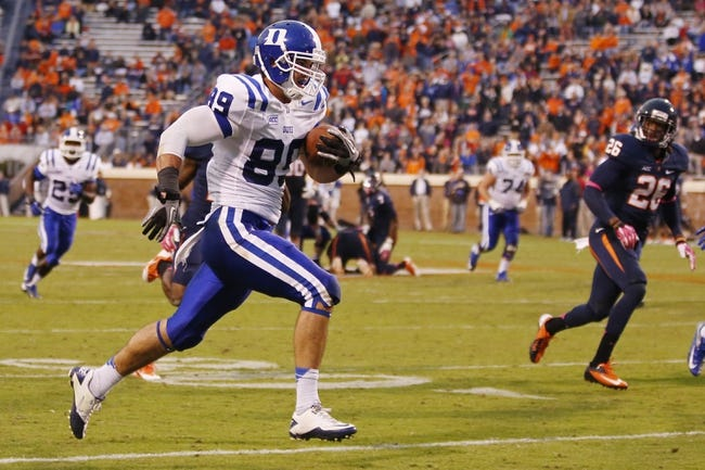 Oct 19, 2013; Charlottesville, VA, USA;  Duke Blue Devils tight end Braxton Deaver (89) runs with the ball to score a touchdown against the Virginia Cavaliers in the fourth quarter at Scott Stadium. The Blue Devils won 35-22. Mandatory Credit: Geoff Burke-USA TODAY Sports