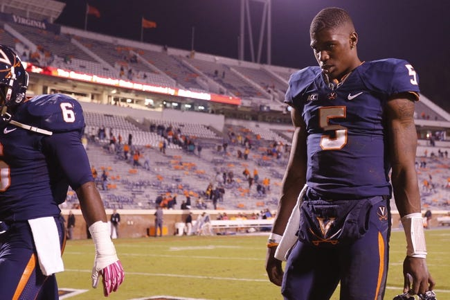 Oct 19, 2013; Charlottesville, VA, USA;  Virginia Cavaliers quarterback David Watford (5) walks off the field after the Cavaliers game against the Duke Blue Devils at Scott Stadium. The Blue Devils won 35-22. Mandatory Credit: Geoff Burke-USA TODAY Sports