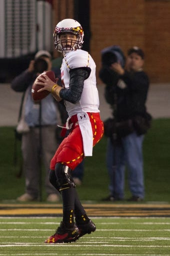 Oct 19, 2013; Winston-Salem, NC, USA; Maryland Terrapins quarterback Caleb Rowe (7) throws a pass during the fourth quarter against the Wake Forest Demon Deacons at BB&T Field. Wake defeated Maryland 34-10. Mandatory Credit: Jeremy Brevard-USA TODAY Sports