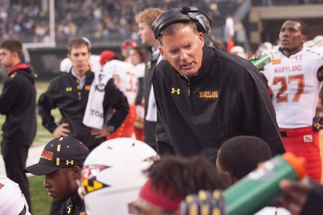 Oct 19, 2013; Winston-Salem, NC, USA;  Maryland Terrapins head coach Randy Edsall talks with a player on the bench during the third quarter against the Wake Forest Demon Deacons at BB&T Field. Wake defeated Maryland 34-10. Mandatory Credit: Jeremy Brevard-USA TODAY Sports
