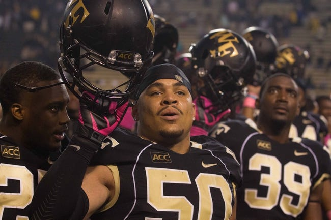 Oct 19, 2013; Winston-Salem, NC, USA; Wake Forest Demon Deacons nose tackle Nikita Whitlock (50) sings the alma mater after defeating the Maryland Terrapins at BB&T Field. Wake defeated Maryland 34-10. Mandatory Credit: Jeremy Brevard-USA TODAY Sports