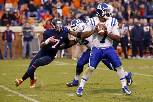 Oct 19, 2013; Charlottesville, VA, USA;  Duke Blue Devils quarterback Anthony Boone (7) prepares to throw the ball as Virginia Cavaliers defensive end Eli Harold (7) chases in the fourth quarter at Scott Stadium. The Blue Devils won 35-22. Mandatory Credit: Geoff Burke-USA TODAY Sports