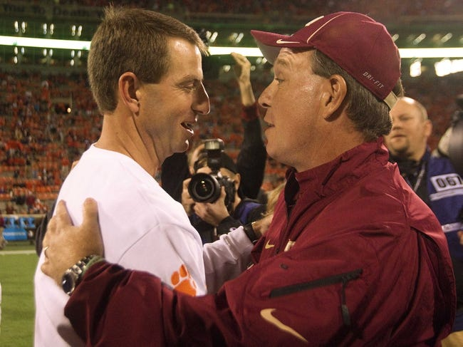 Oct 19, 2013; Clemson, SC, USA; Clemson Tigers head coach Dabo Swinney (left) shakes hands with Florida State Seminoles head coach Jimbo Fisher (right) prior to the game at Clemson Memorial Stadium. Mandatory Credit: Joshua S. Kelly-USA TODAY Sports