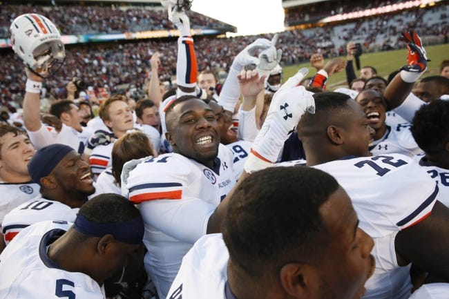 Oct 19, 2013; College Station, TX, USA;  Auburn Tigers celebrate their 45-41 victory against the Texas A&M Aggies at Kyle Field. Mandatory Credit: Soobum Im-USA TODAY Sports