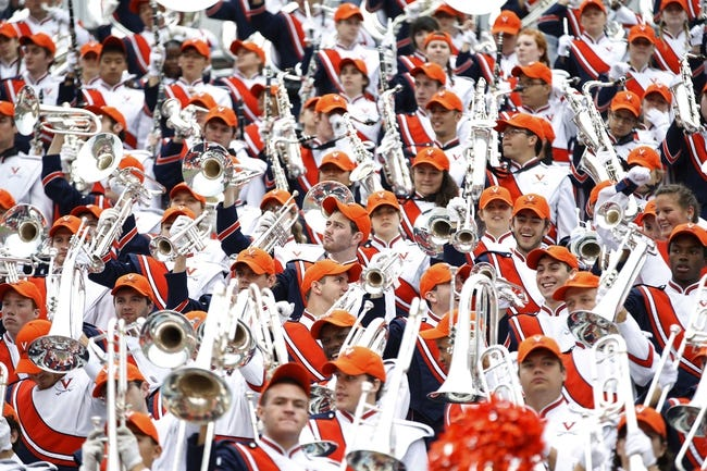 Oct 19, 2013; Charlottesville, VA, USA;  The Virginia Cavaliers marching band cheers in the stands against the Duke Blue Devils in the second quarter at Scott Stadium. The Blue Devils won 35-22. Mandatory Credit: Geoff Burke-USA TODAY Sports