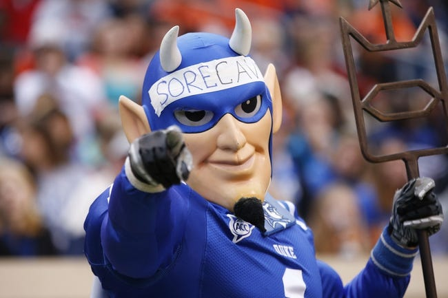 Oct 19, 2013; Charlottesville, VA, USA; The Duke Blue Devils mascot cheers from the sidelines against the Virginia Cavaliers in the third quarter at Scott Stadium. The Blue Devils won 35-22. Mandatory Credit: Geoff Burke-USA TODAY Sports