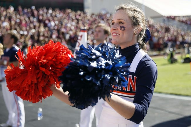 Oct 19, 2013; College Station, TX, USA; Auburn Tigers cheerleader performs during the first half against the Texas A&M Aggies at Kyle Field. Mandatory Credit: Soobum Im-USA TODAY Sports