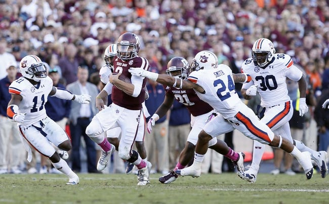 Oct 19, 2013; College Station, TX, USA; Texas A&M Aggies quarterback Johnny Manziel (2) tries to run past Auburn Tigers defensive back Ryan Smith (24) during the second half at Kyle Field. Mandatory Credit: Soobum Im-USA TODAY Sports