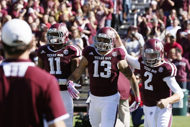 Oct 19, 2013; College Station, TX, USA; Texas A&M Aggies wide receiver Mike Evans (13) celebrates with quarterback Johnny Manziel (2) after scoring a touchdown against the Auburn Tigers during the first half at Kyle Field. Mandatory Credit: Soobum Im-USA TODAY Sports