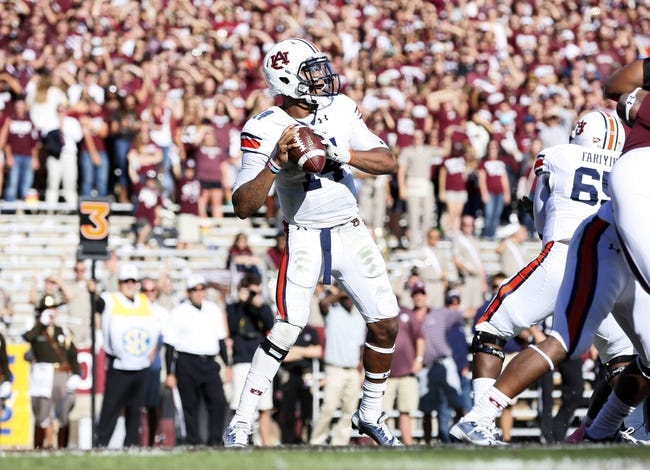 Oct 19, 2013; College Station, TX, USA; Auburn Tigers quarterback Nick Marshall (14) looks to make a pass against the Texas A&M Aggies during the first half at Kyle Field. Mandatory Credit: Soobum Im-USA TODAY Sports