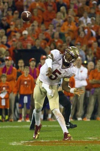 Oct 19, 2013; Clemson, SC, USA; Florida State Seminoles quarterback Jameis Winston (5) throws the ball during the first quarter against the Clemson Tigers at Clemson Memorial Stadium. Mandatory Credit: Joshua S. Kelly-USA TODAY Sports