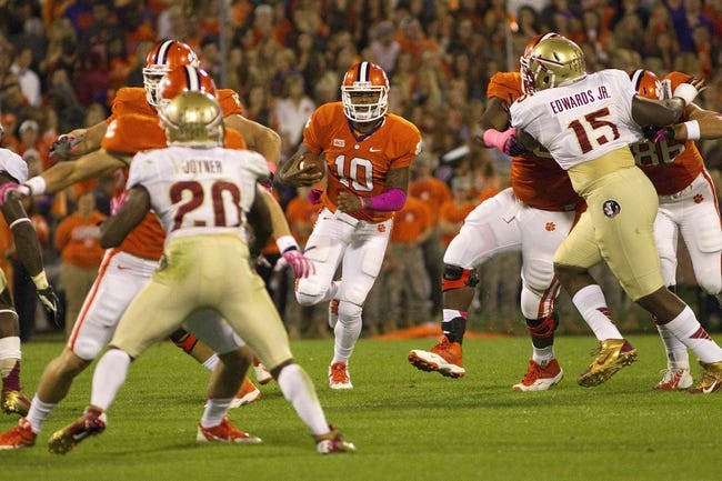 Oct 19, 2013; Clemson, SC, USA; Clemson Tigers quarterback Tajh Boyd (10) on a quarterback keeper during the first quarter against the Florida State Seminoles at Clemson Memorial Stadium. Mandatory Credit: Joshua S. Kelly-USA TODAY Sports