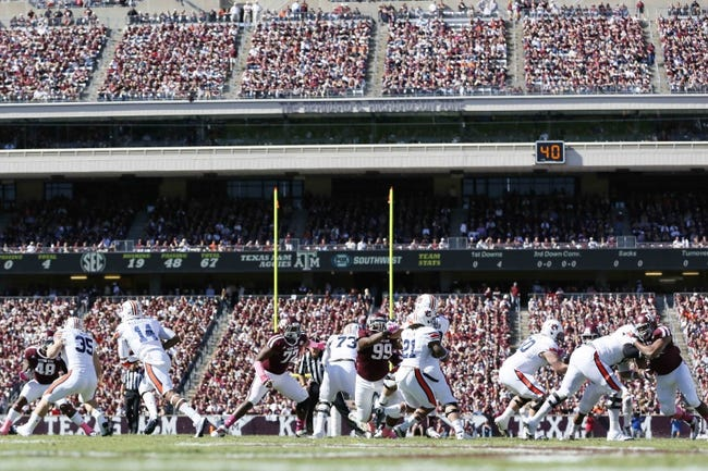 Oct 19, 2013; College Station, TX, USA; Auburn Tigers running back Tre Mason (21) runs with the ball against the Texas A&M Aggies during the first half at Kyle Field. Mandatory Credit: Soobum Im-USA TODAY Sports