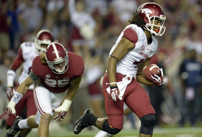 Oct 19, 2013; Tuscaloosa, AL, USA; Arkansas Razorbacks wide receiver Keon Hatcher (4) carries the ball up the field against the Alabama Crimson Tide during the first quarter at Bryant-Denny Stadium. Mandatory Credit: John David Mercer-USA TODAY Sports