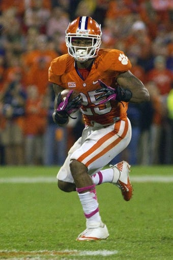 Oct 19, 2013; Clemson, SC, USA; Clemson Tigers running back Roderick McDowell (25) carries the ball during the first half against the Florida State Seminoles at Clemson Memorial Stadium. Mandatory Credit: Joshua S. Kelly-USA TODAY Sports