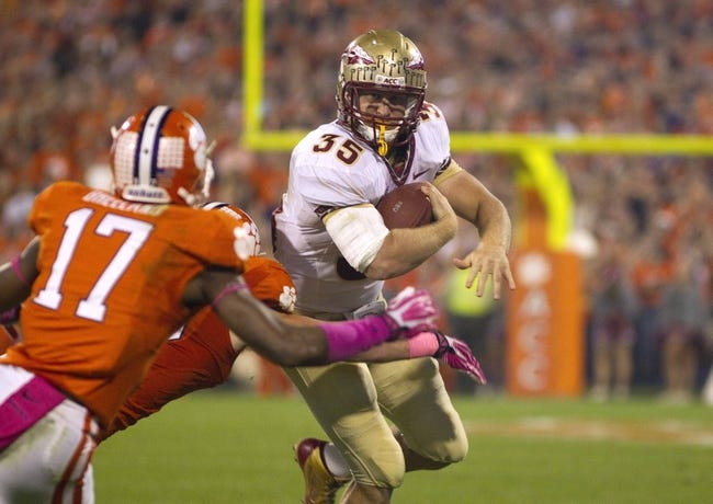 Oct 19, 2013; Clemson, SC, USA; Florida State Seminoles tight end Nick O'Leary (35) carries the ball while being defended by Clemson Tigers defensive back Bashaud Breeland (17) during the first half at Clemson Memorial Stadium. Mandatory Credit: Joshua S. Kelly-USA TODAY Sports