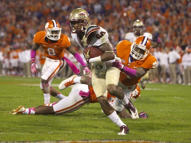 Oct 19, 2013; Clemson, SC, USA; Florida State Seminoles wide receiver Rashad Greene (80) rushes for a touchdown during the third quarter against the Clemson Tigers at Clemson Memorial Stadium. Mandatory Credit: Joshua S. Kelly-USA TODAY Sports