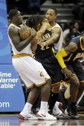 Oct 19, 2013; Cleveland, OH, USA; Cleveland Cavaliers forward Anthony Bennett (15) and forward Kenny Kadji (35) fight with Indiana Pacers forward Chris Copeland (22) for a rebound during the fourth quarter at Quicken Loans Arena. The Pacers beat the Cavaliers 102-79. Mandatory Credit: Ken Blaze-USA TODAY Sports