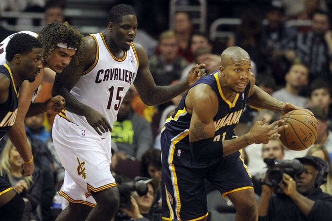 Oct 19, 2013; Cleveland, OH, USA; Indiana Pacers forward David West (21) grabs a rebound and runs from Cleveland Cavaliers forward Anthony Bennett (15) and forward Anderson Varejo (17) during the second half at Quicken Loans Arena. The Pacers beat the Cavaliers 102-79. Mandatory Credit: Ken Blaze-USA TODAY Sports