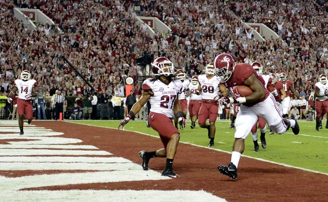 Oct 19, 2013; Tuscaloosa, AL, USA; Alabama Crimson Tide running back Jalston Fowler (45) runs into the end zone for a touchdown against the Arkansas Razorbacks during the first quarter at Bryant-Denny Stadium. Mandatory Credit: John David Mercer-USA TODAY Sports