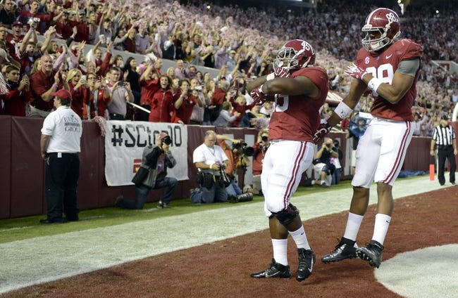 Oct 19, 2013; Tuscaloosa, AL, USA; Alabama Crimson Tide running back Jalston Fowler (45) celebrates his touchdown with tight end O.J. Howard (88) against the Arkansas Razorbacks during the first quarter at Bryant-Denny Stadium. Mandatory Credit: John David Mercer-USA TODAY Sports