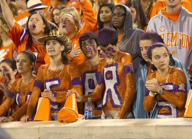 Oct 19, 2013; Clemson, SC, USA; Clemson Tigers fans react during the third quarter against the Florida State Seminoles at Clemson Memorial Stadium. Mandatory Credit: Joshua S. Kelly-USA TODAY Sports
