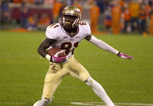 Oct 19, 2013; Clemson, SC, USA; Florida State Seminoles wide receiver Kenny Shaw (81) carries the ball during the third quarter against the Clemson Tigers at Clemson Memorial Stadium. Mandatory Credit: Joshua S. Kelly-USA TODAY Sports