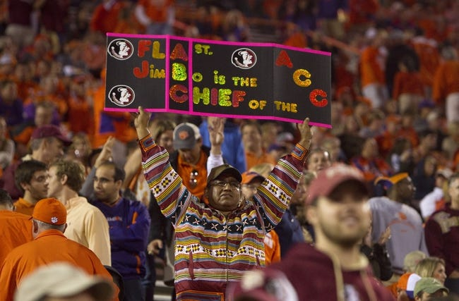 Oct 19, 2013; Clemson, SC, USA; Florida State Seminoles fan reacts during the fourth quarter against the Clemson Tigers at Clemson Memorial Stadium. Mandatory Credit: Joshua S. Kelly-USA TODAY Sports