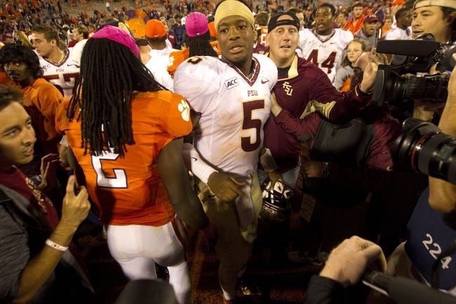 Oct 19, 2013; Clemson, SC, USA;Florida State Seminoles quarterback Jameis Winston (5) celebrates with teammates following against the Clemson Tigers the game at Clemson Memorial Stadium. Seminoles won 51-14. Mandatory Credit: Joshua S. Kelly-USA TODAY Sports