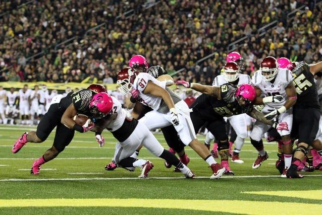 Oct 19, 2013; Eugene, OR, USA; Washington State Cougars linebacker Cyrus Coen (42) blocks Oregon Ducks running back Thomas Tyner (24) at Autzen Stadium. Mandatory Credit: Scott Olmos-USA TODAY Sports