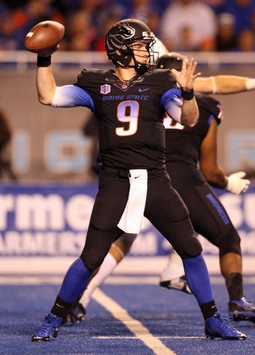 Oct 19, 2013; Boise, ID, USA; Boise State Broncos quarterback Grant Hedrick (9) throws the ball during the second half against the Nevada Wolf Pack at Bronco Stadium. The Broncos won 34-17. Mandatory Credit: Brian Losness-USA TODAY Sports