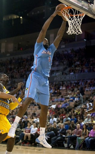 Oct 19, 2013; Las Vegas, NV, USA; Los Angeles Clippers center DeAndre Jordan (6) rims the ball during a dunk attempt after being fouled during an NBA preseason game against the Denver Nuggets at Mandalay Bay Events Center. Mandatory Credit: Stephen R. Sylvanie-USA TODAY Sports
