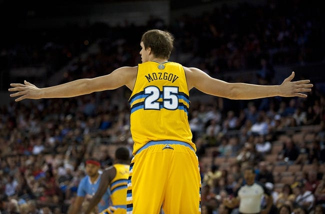 Oct 19, 2013; Las Vegas, NV, USA; Denver Nuggets center Timofey Mozgov (25) extends his arms out while playing defense against the Los Angeles Clippers during an NBA preseason game at Mandalay Bay Events Center. Mandatory Credit: Stephen R. Sylvanie-USA TODAY Sports