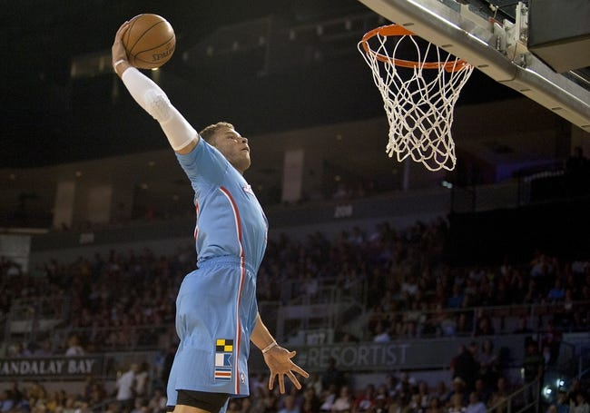 Oct 19, 2013; Las Vegas, NV, USA; Los Angeles Clippers forward Blake Griffin leaps towards the basket for a dunk during an NBA preseason game against the Denver Nuggets at Mandalay Bay Events Center. Mandatory Credit: Stephen R. Sylvanie-USA TODAY Sports