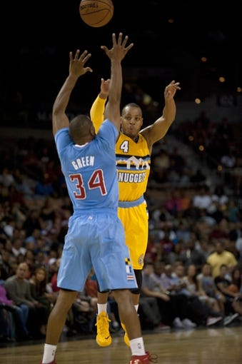 Oct 19, 2013; Las Vegas, NV, USA; Denver Nuggets guard Randy Foye (4) passes the ball over defending Los Angeles Clippers guard Willie Green (34) during an NBA preseason game at Mandalay Bay Events Center. Mandatory Credit: Stephen R. Sylvanie-USA TODAY Sports